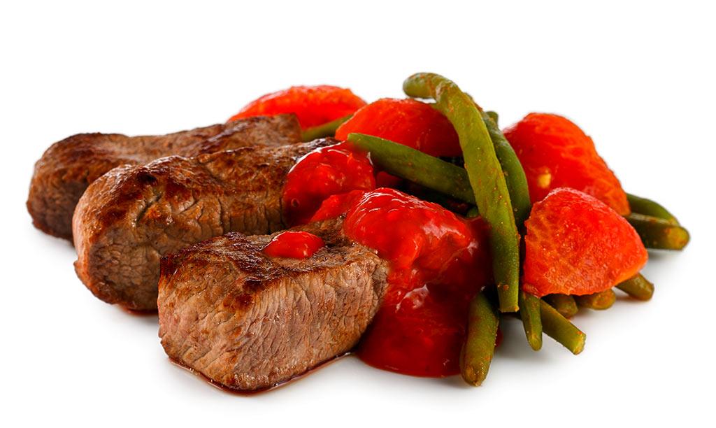 Lamb steak, tomatoes and beans