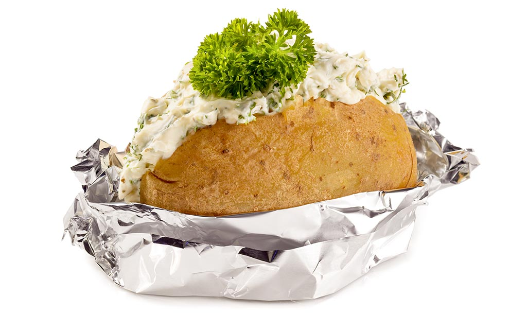 Foil potatoes with fresh cheese