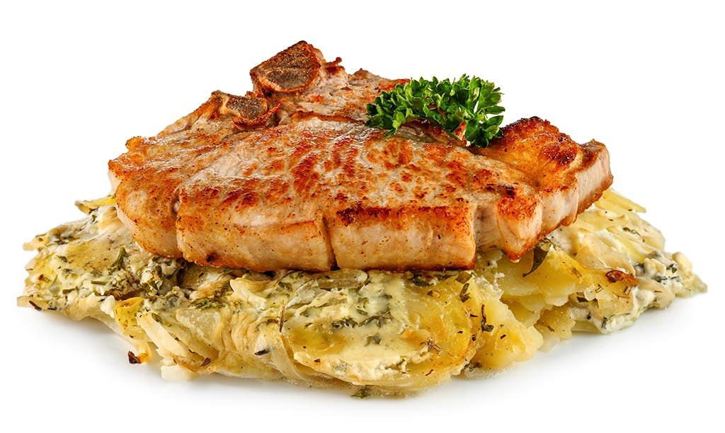 Pork cutlet on potato gratin