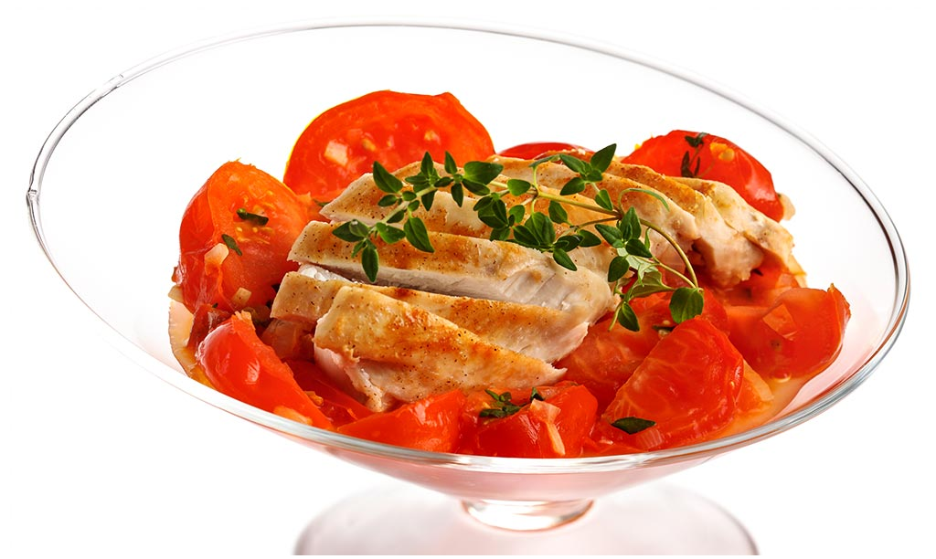 Chicken breast fillet with tomatoes vegetables