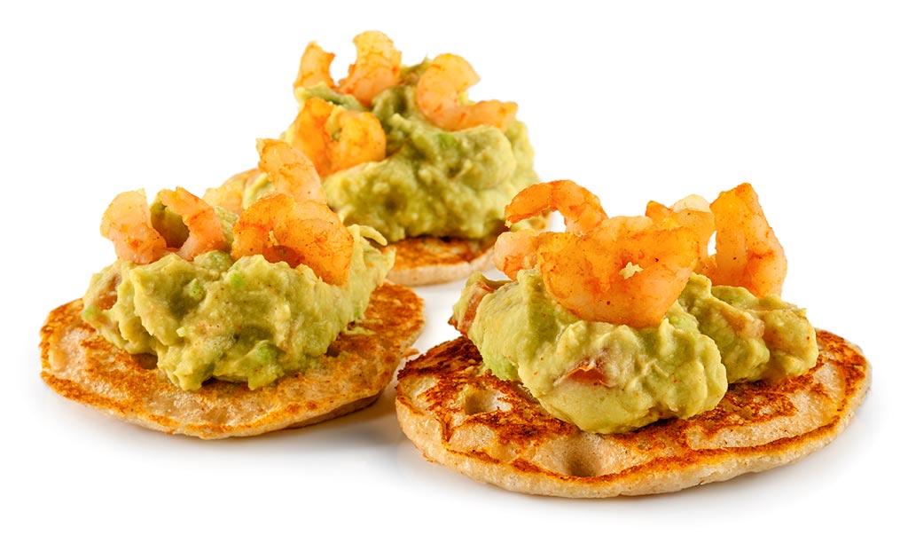 Blinis with avocado cream and shrimps