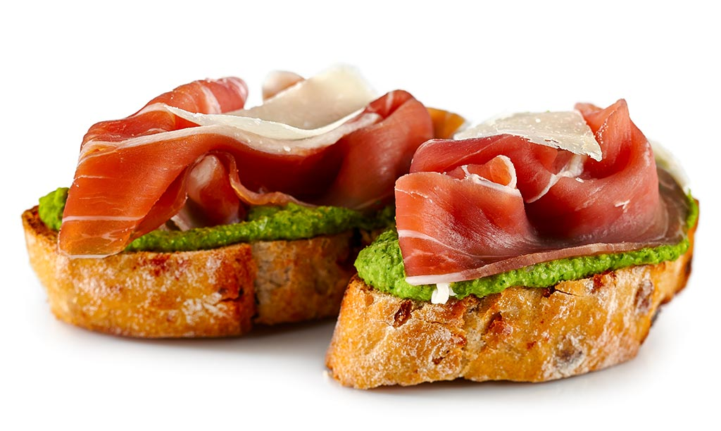 Bruschetta with ham and pesto