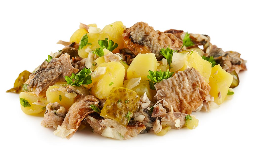 Pell potatoes with fried herring salad