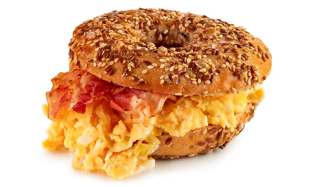 Breakfast bagel with scrambled egg and bacon