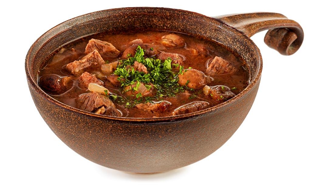 Beef goulash soup in roman pot